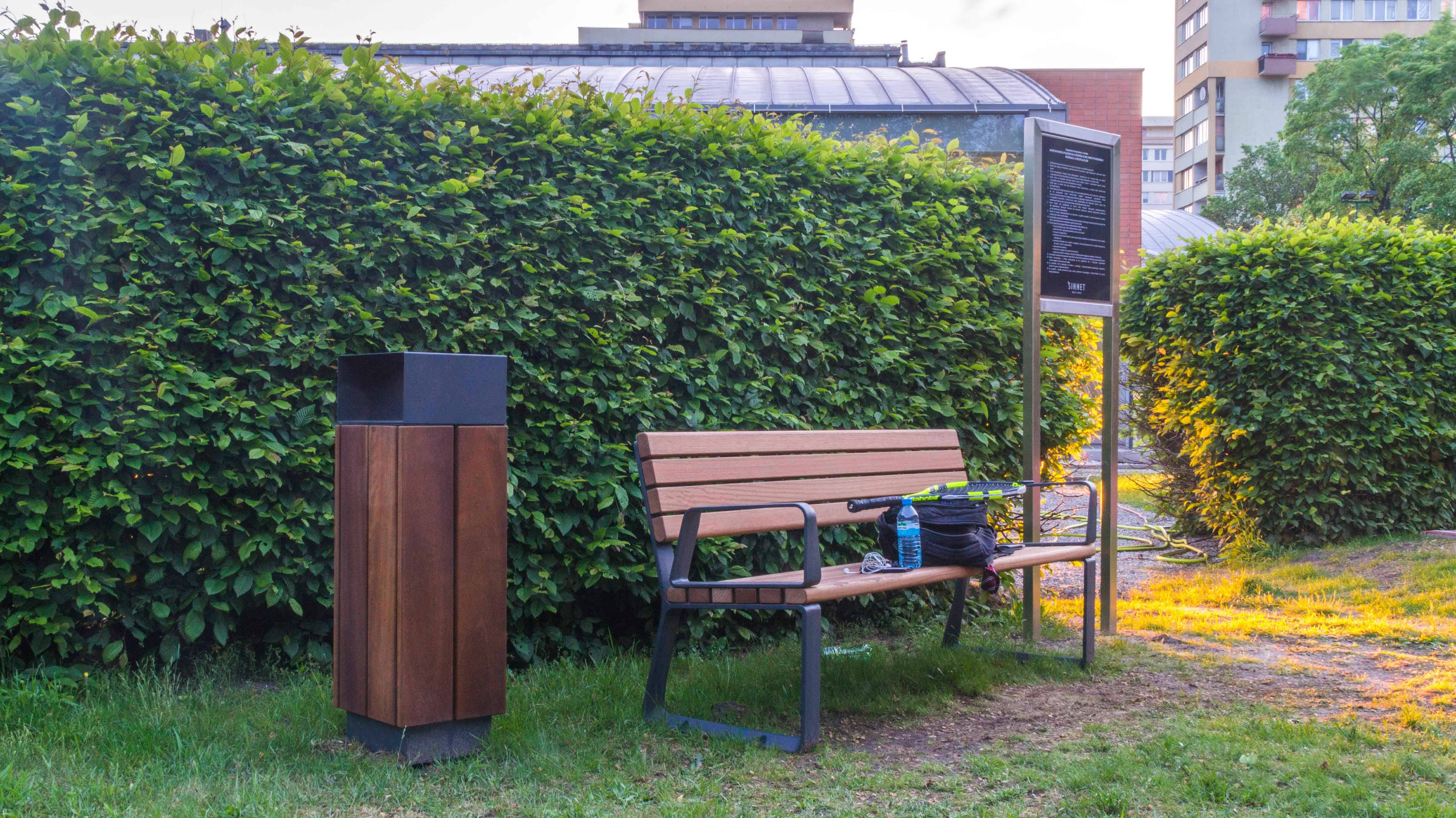wood park bench and trash receptacle