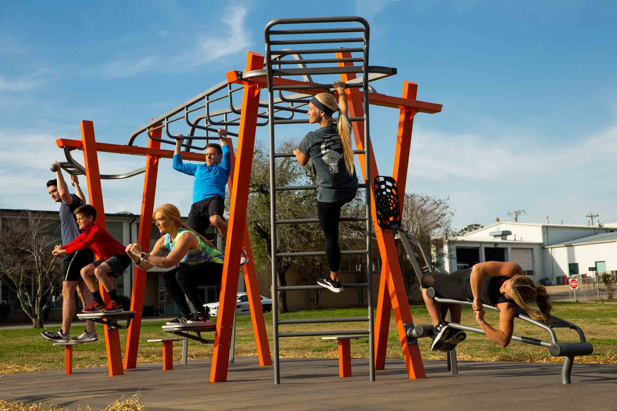 adults using compact fitness equipment