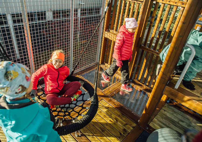 kids play inside tower playground